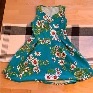 Teal sleeveless dress with floral pattern Size M